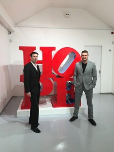 Dr. Diego Giolitti and Cristian Contini in front of Robert Indiana's 'HOPE' art work